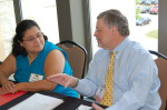 Rachel Konzem and Alan Ingram, NASW-MN Exec. Director register participants