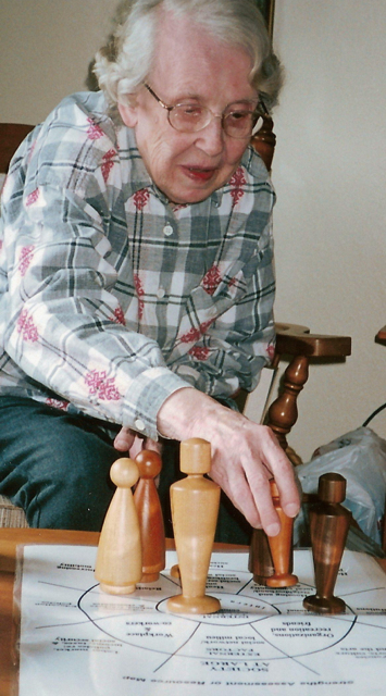 Elderly lady sculpts to show herself, friends, and family after her move from her own home to a community setting.
